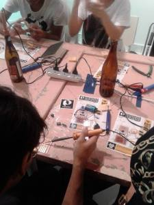 We even recycle the beer bottles to become soldering iron holders in our workshops! Waste not!